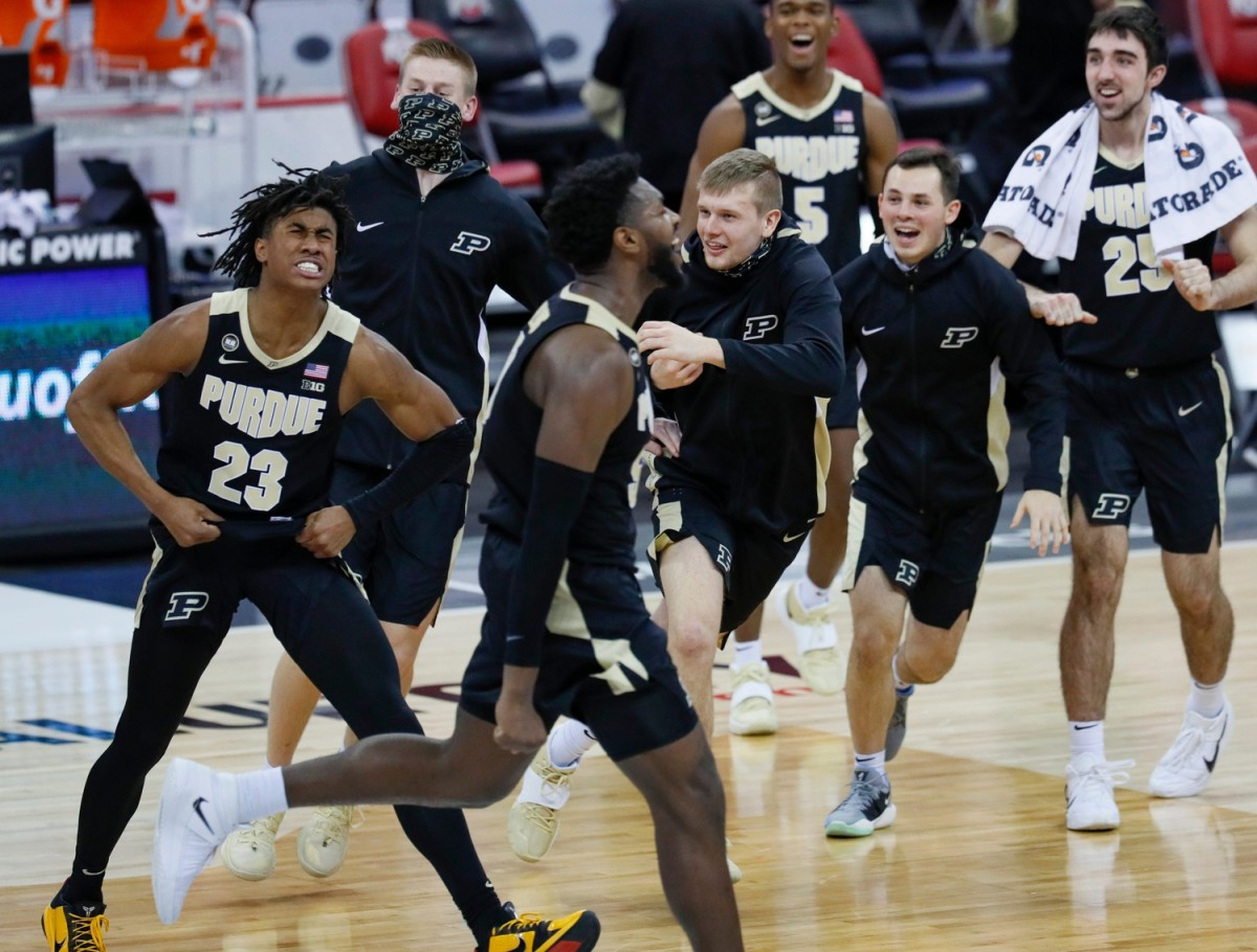 Jaden Ivey (23) celebrates with his teammates after hitting the game-winning three-pointer against Ohio State on Tuesday night. (USA TODAY Sports_
