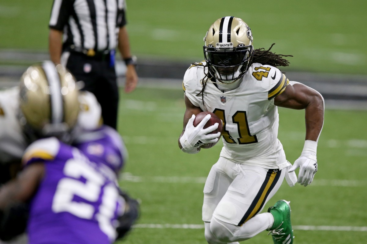 Dec 25, 2020; New Orleans, Louisiana, USA; New Orleans Saints running back Alvin Kamara (41) runs against the Minnesota Vikings in the second quarter at the Mercedes-Benz Superdome. Mandatory Credit: Chuck Cook-USA TODAY