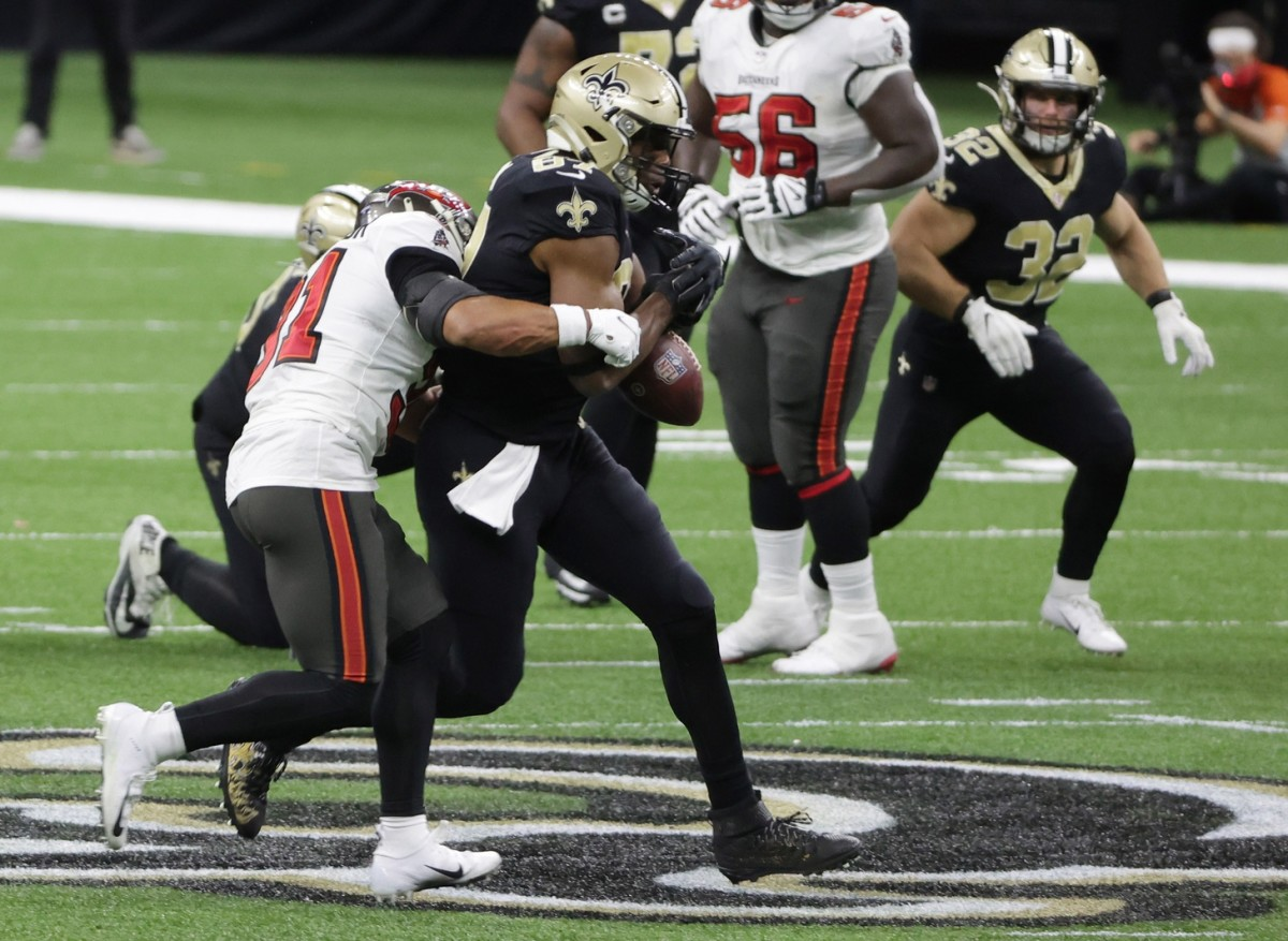 Jan 17, 2021; New Orleans, LA, USA; Tampa Bay safety Antoine Winfield Jr. (31) forces New Orleans Saints tight end Jared Cook (87) to fumble during the third quarter in a NFC Divisional Round playoff game at Mercedes-Benz Superdome. Mandatory Credit: Derick E. Hingle-USA TODAY