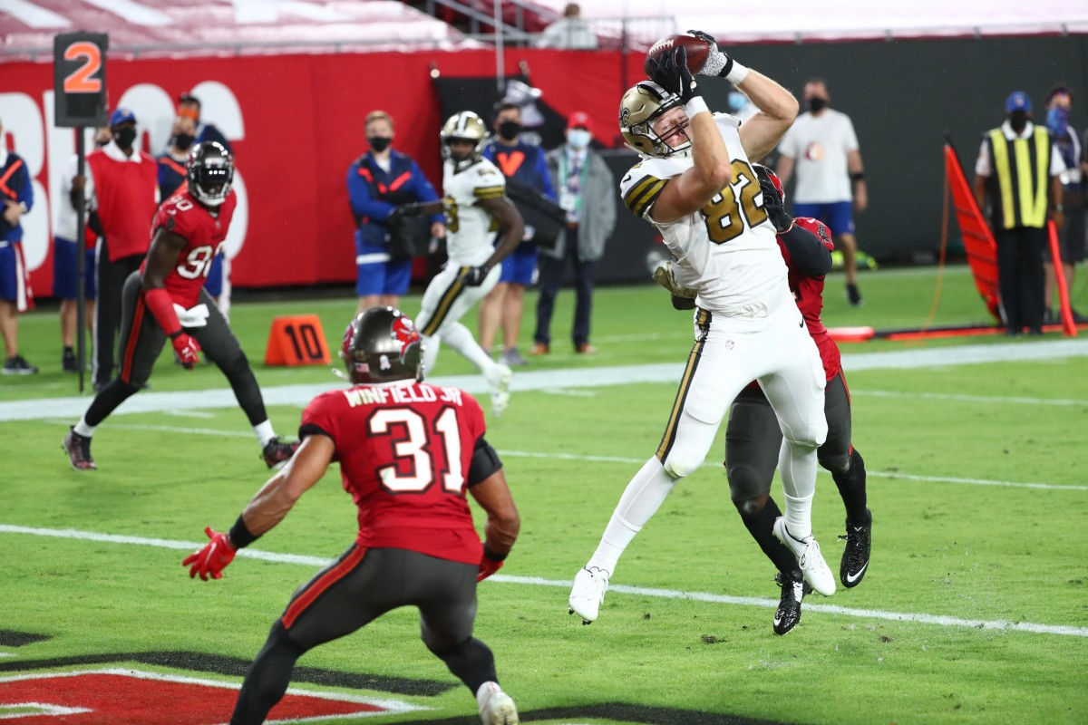 Nov 8, 2020; Tampa, Florida, USA; New Orleans Saints tight end Adam Trautman (82) catches a touchdown pass against the Tampa Bay Buccaneers in the first quarter of a NFL game at Raymond James Stadium. Mandatory Credit: Kim Klement-USA TODAY