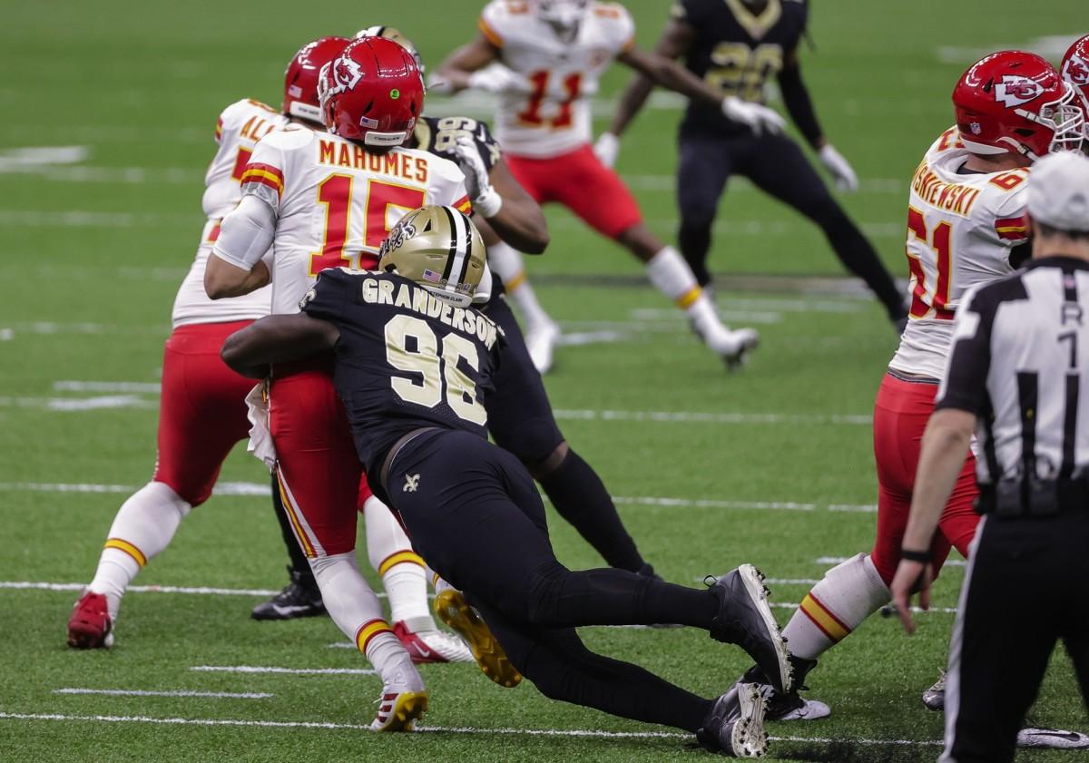 Dec 20, 2020; New Orleans, Louisiana, USA; Saints defensive end Carl Granderson (96) sacks Chiefs quarterback Patrick Mahomes (15) during the first half at the Mercedes-Benz Superdome. Mandatory Credit: Derick E. Hingle-USA TODAY Sports