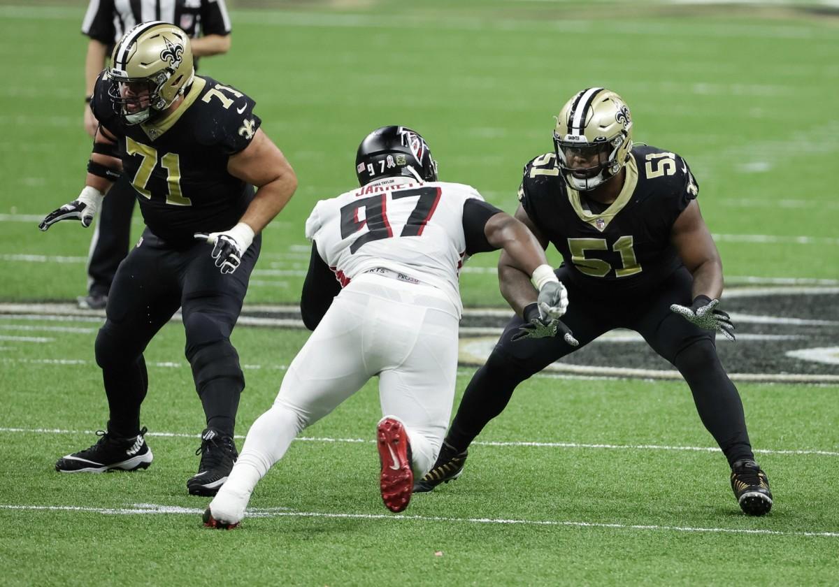 Nov 22, 2020; New Orleans, Louisiana, USA; Cesar Ruiz (51) blocks Atlanta Falcons defensive tackle Grady Jarrett (97) during the second half at the Mercedes-Benz Superdome. Mandatory Credit: Derick E. Hingle-USA TODAY