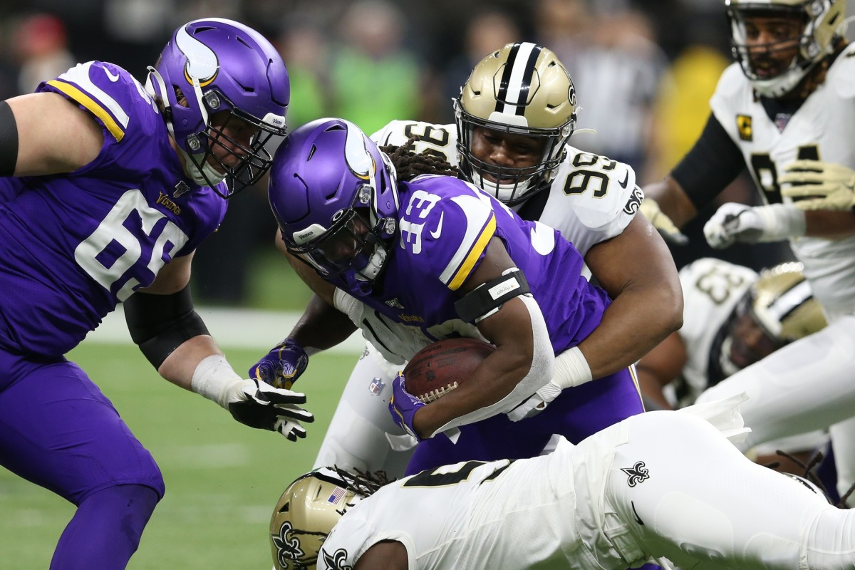 Jan 5, 2020; New Orleans, Louisiana, USA; New Orleans defensive tackle Shy Tuttle (99) tackles Vikings running back Dalvin Cook (33) during the first quarter of a NFC Wild Card playoff football game at the Mercedes-Benz Superdome. Mandatory Credit: Chuck Cook -USA TODAY Sports