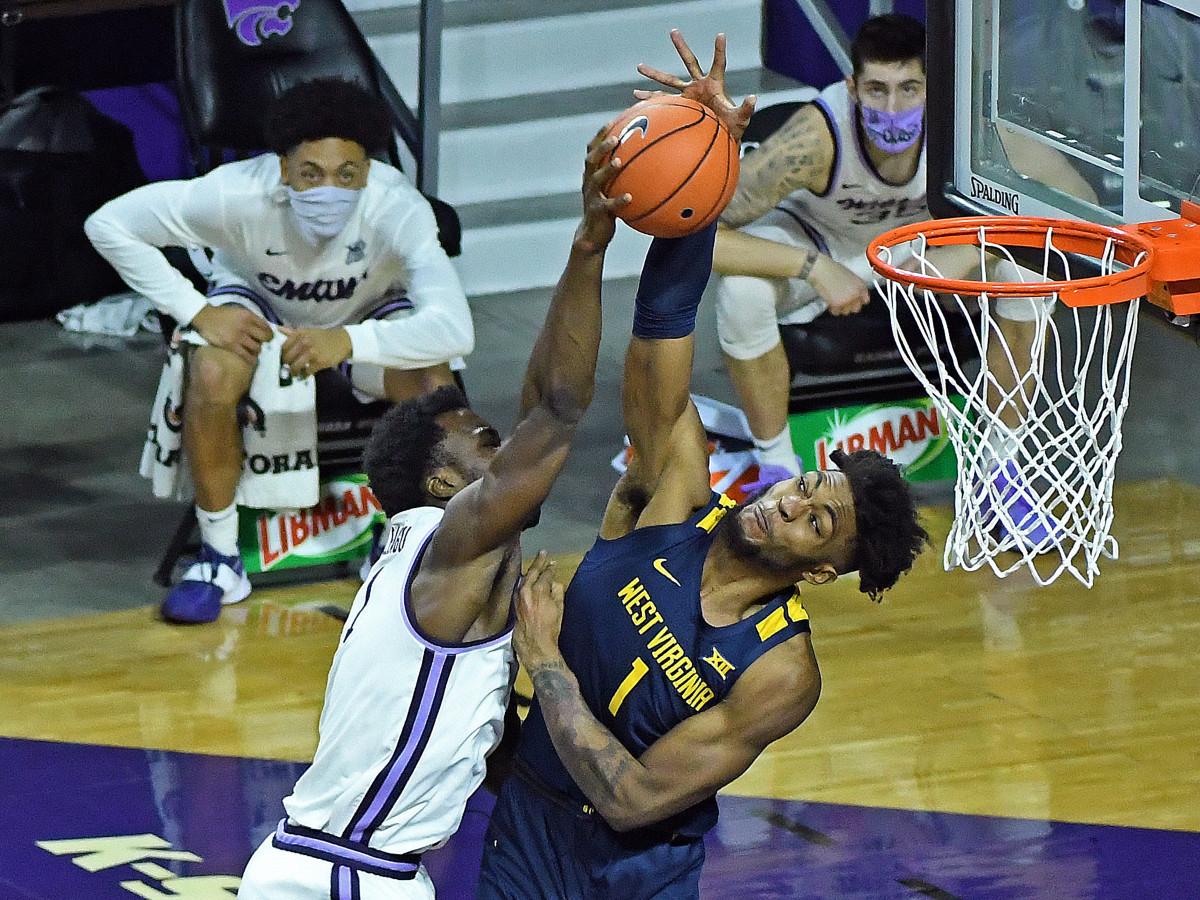 West Virginia forward Derek Culver blocks Kansas the dunk of Kansas State forward Kaosi Ezeagu early in the second half action.