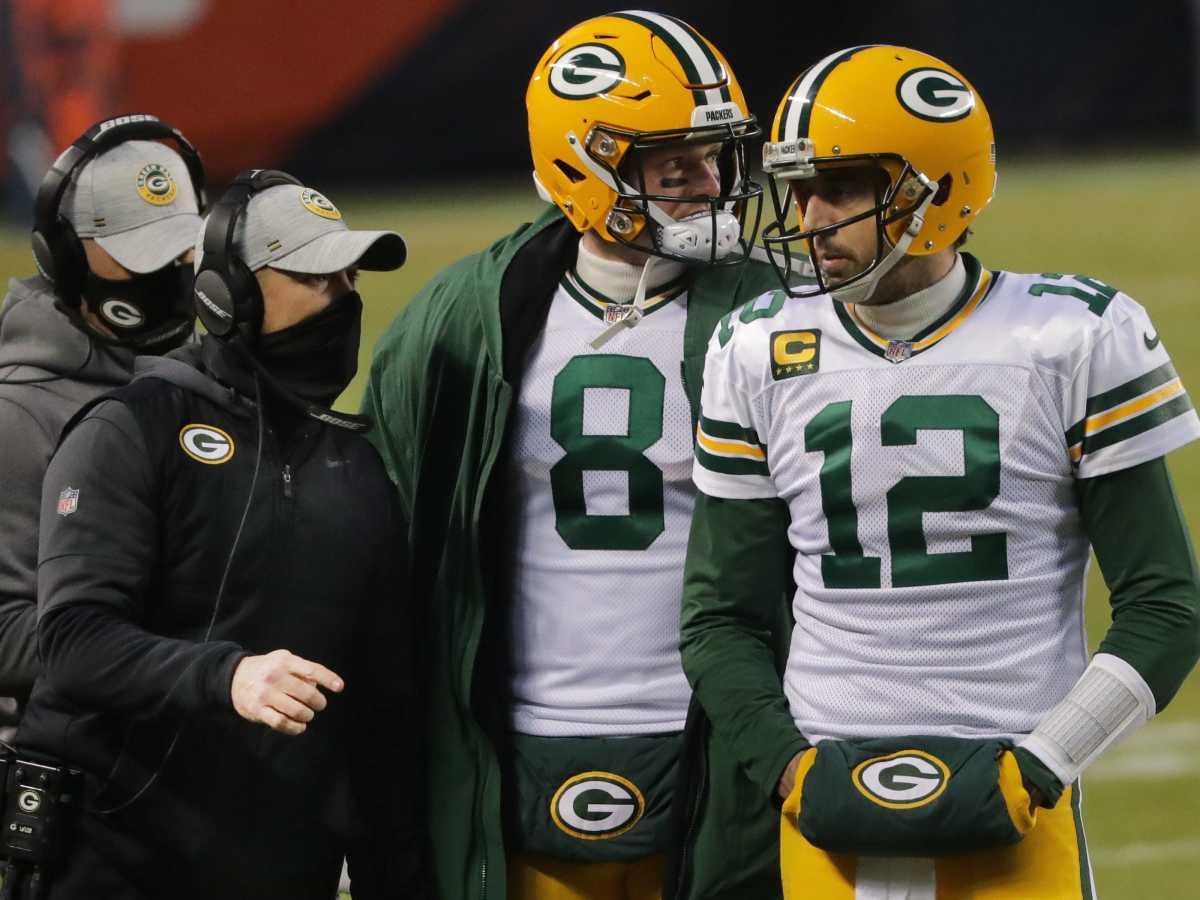 Green Bay Packers head coach Matt LaFleur talks with quarterbacks Aaron Rodgers (12) and Tim Boyle (8)