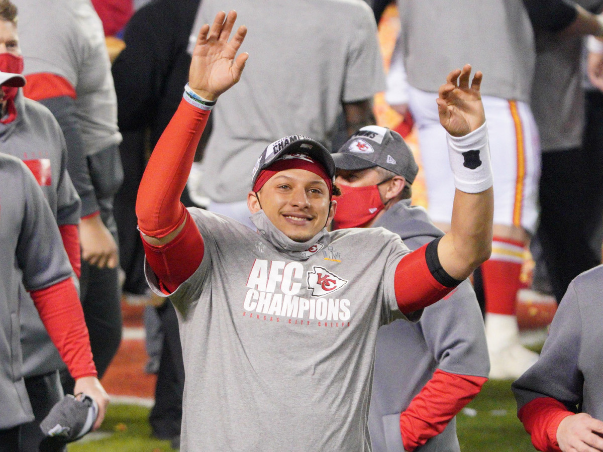 Kansas City Chiefs quarterback Patrick Mahomes waves to the crowd after defeating the Buffalo Bills in the AFC Championship Game at Arrowhead Stadium.