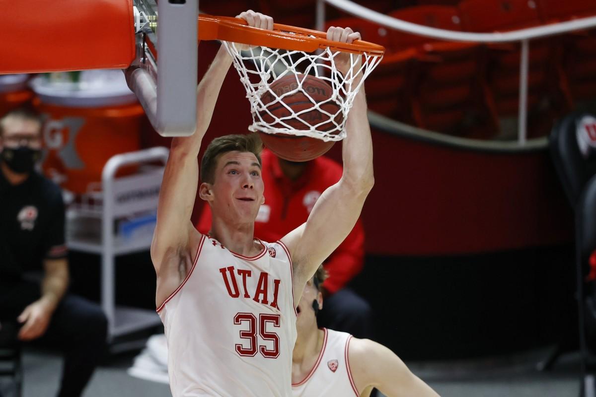 Jan 9, 2021; Salt Lake City, Utah, USA; Utah Utes center Branden Carlson (35) dunks the ball in the second half against the Oregon Ducks at Jon M. Huntsman Center.