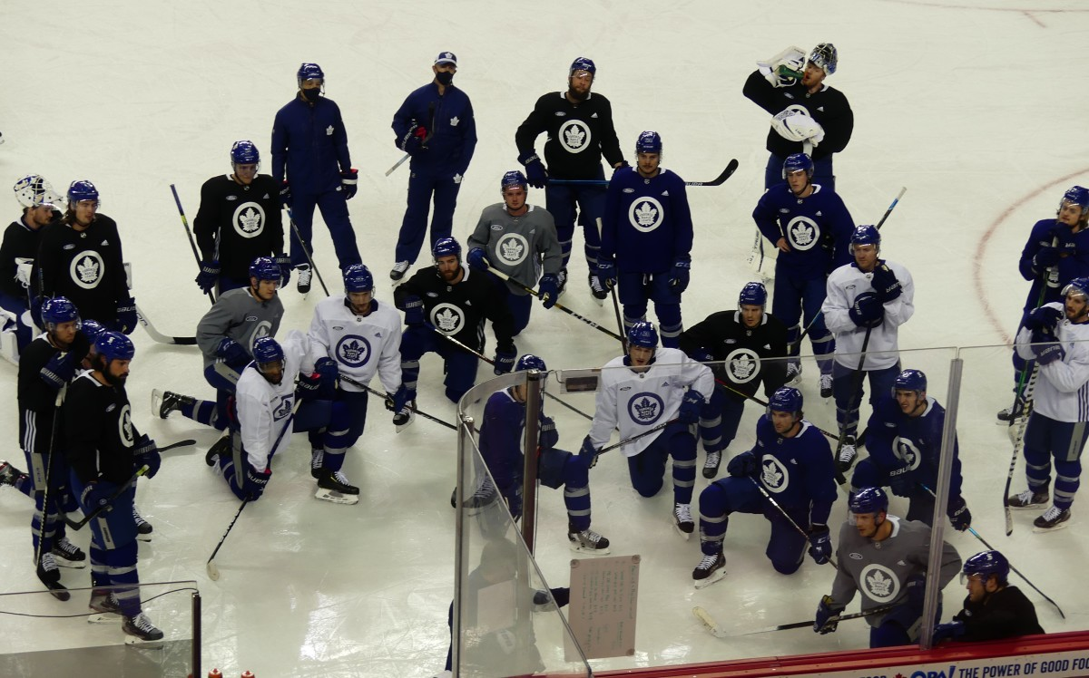 Toronto Maple Leafs huddled up for instruction from head coach Sheldon Keefe during practice at Scotiabank Saddledome on Monday.