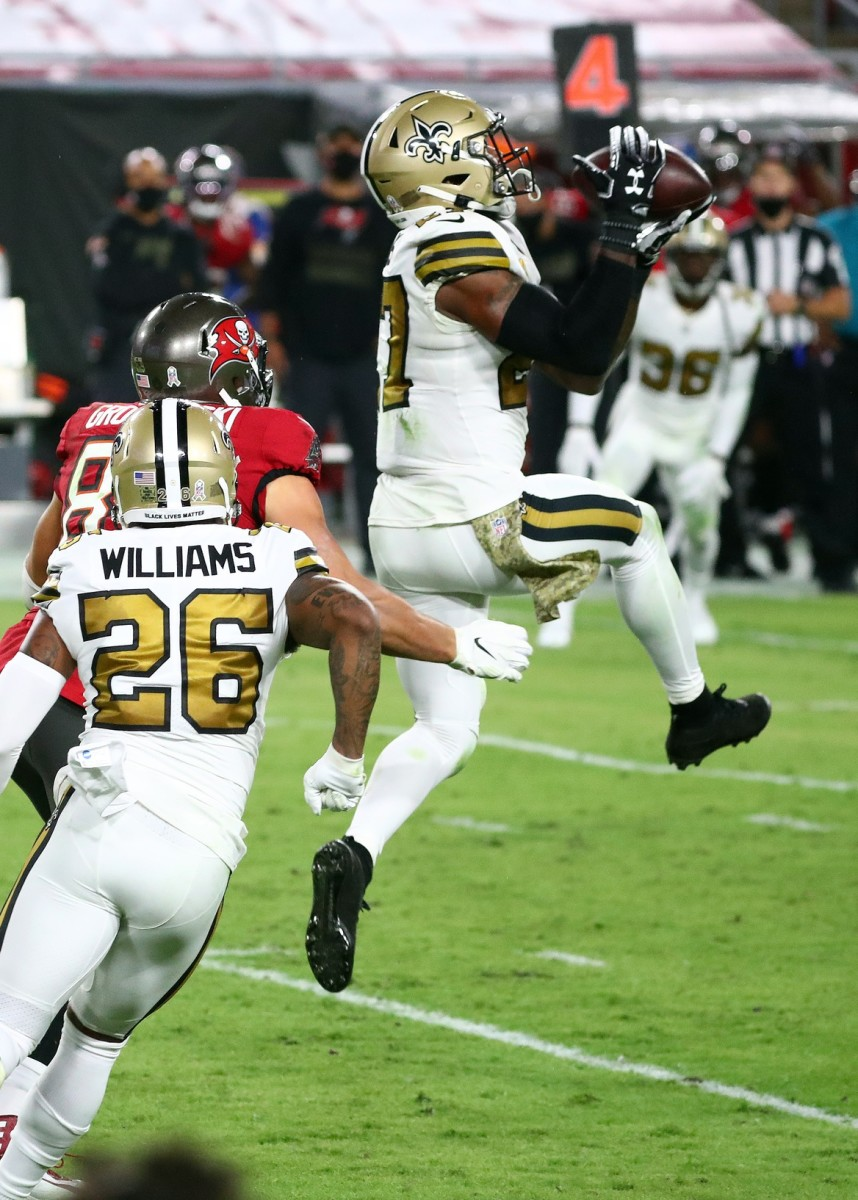 Nov 8, 2020; Tampa, Florida, USA; New Orleans safety Malcolm Jenkins (27) intercepts the ball against the Buccaneers during the second half at Raymond James Stadium. Mandatory Credit: Kim Klement-USA TODAY