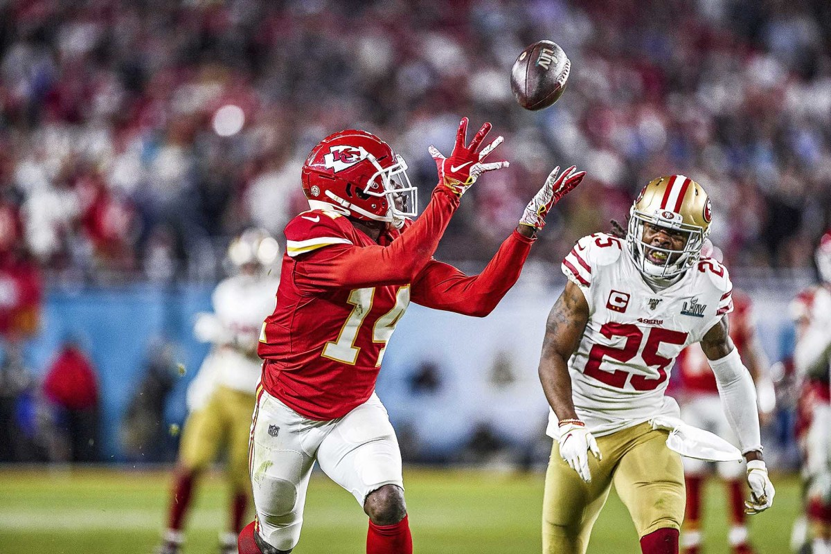 The Chiefs' Sammy Watkins catches a pass over the 49ers' Richard Sherman in Super Bowl LIV