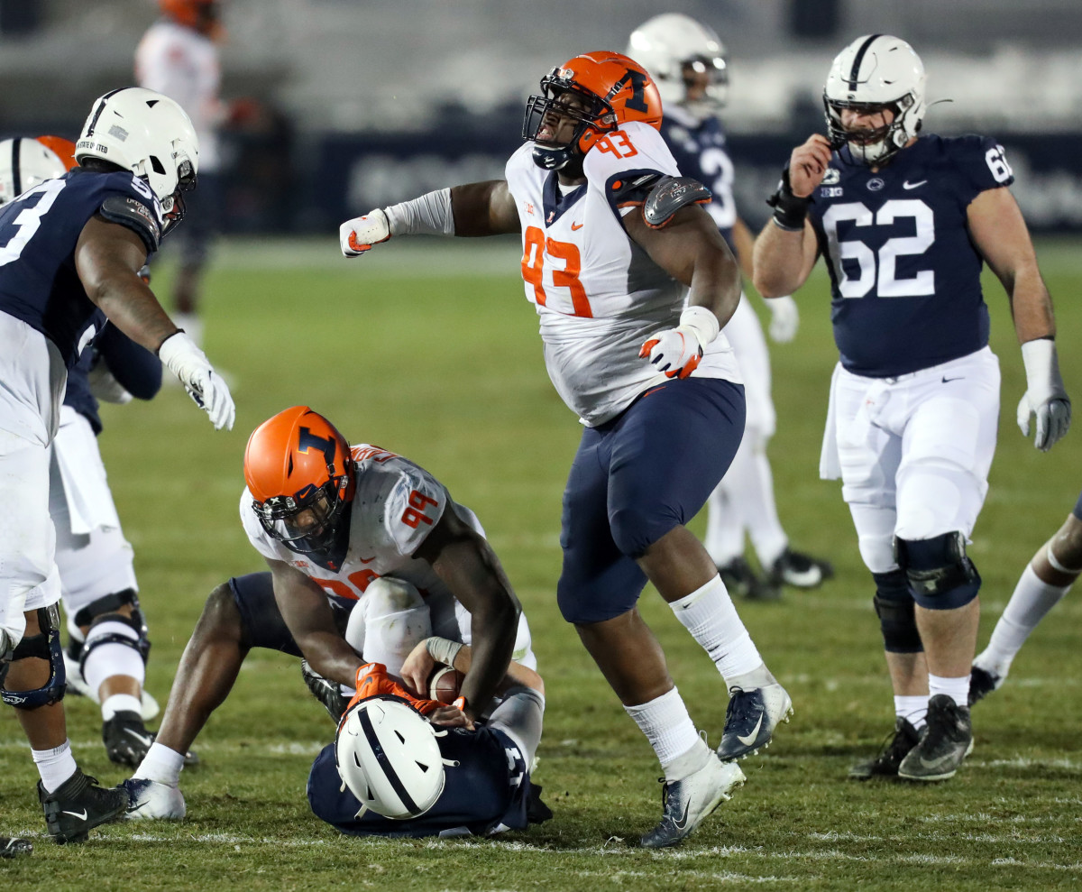 Illinois Fighting Illini defensive linesman Calvin Avery (93) reacts following a sack on Penn State Nittany Lions quarterback Sean Clifford (14) during the fourth quarter at Beaver Stadium. Penn State defeated Illinois 56-21.