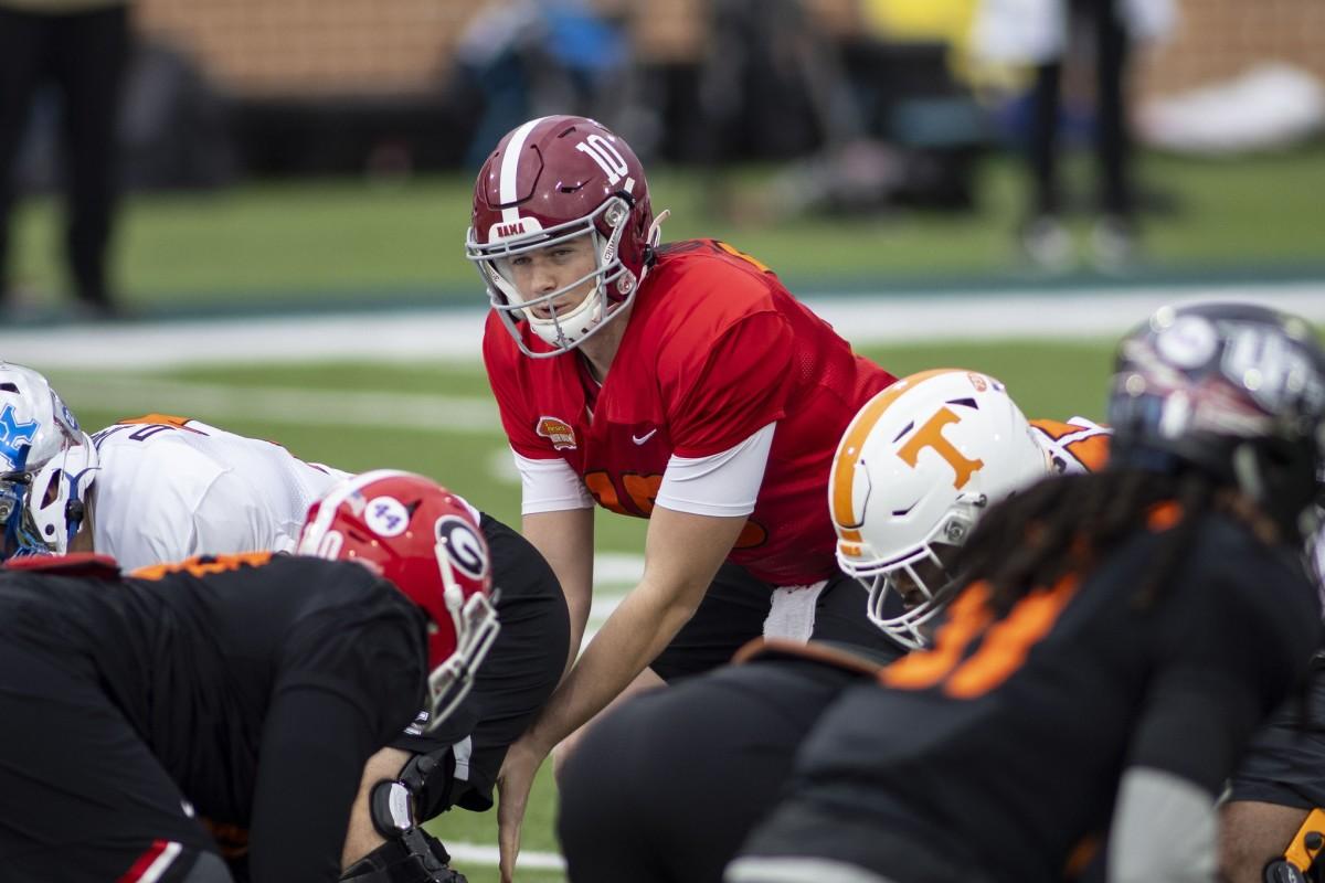 American quarterback Mac Jones of Alabama (10) runs a play in drills during National team practice during the 2021 Senior Bowl week.