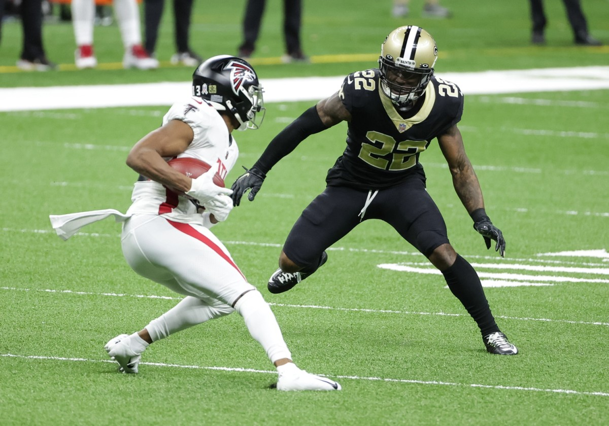 Nov 22, 2020; New Orleans, Louisiana, USA; Saints safety Chauncey Gardner-Johnson (22) tackles Falcons wide receiver Russell Gage (83) during the first quarter at the Mercedes-Benz Superdome. Mandatory Credit: Derick E. Hingle-USA TODAY Sports