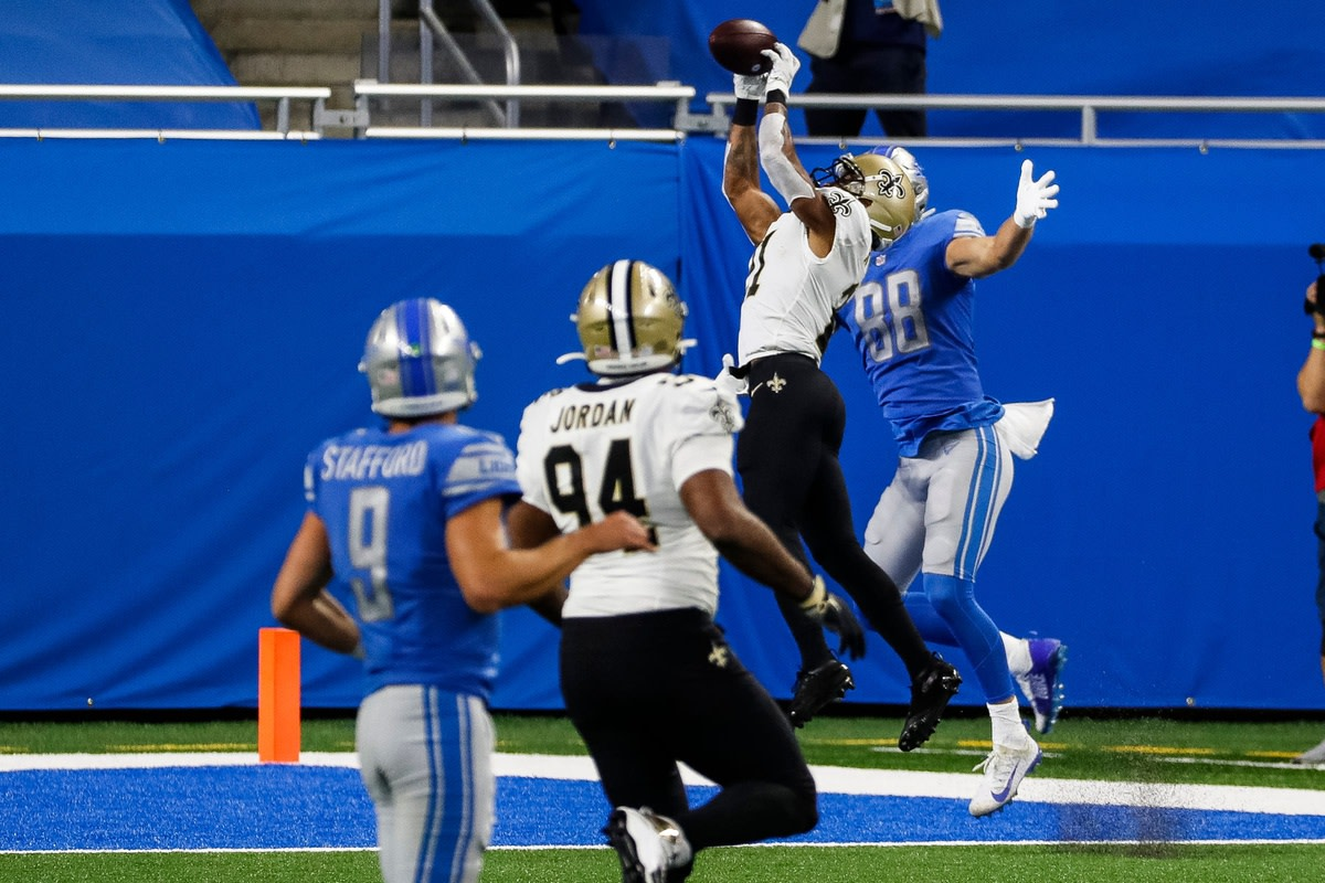 New Orleans Saints cornerback Patrick Robinson intercepts the pass intended for Detroit Lions tight end T.J. Hockenson during the first half at Ford Field, Sunday, October 4, 2020. © Junfu Han via Imagn Content Services, LLC