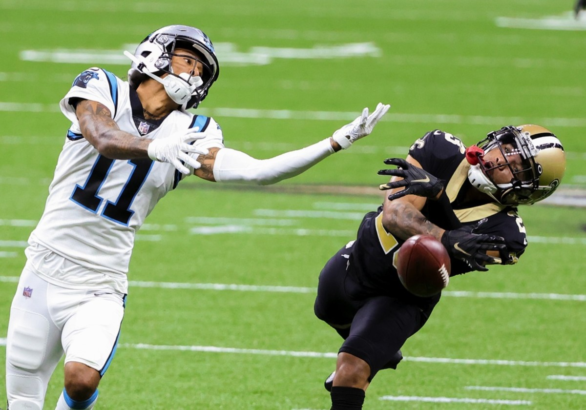 Oct 25, 2020; New Orleans, Louisiana, USA; New Orleans cornerback Marshon Lattimore (23) defends against Carolina wide receiver Robby Anderson (11) during the second half at the Mercedes-Benz Superdome. Mandatory Credit: Derick E. Hingle-USA TODAY