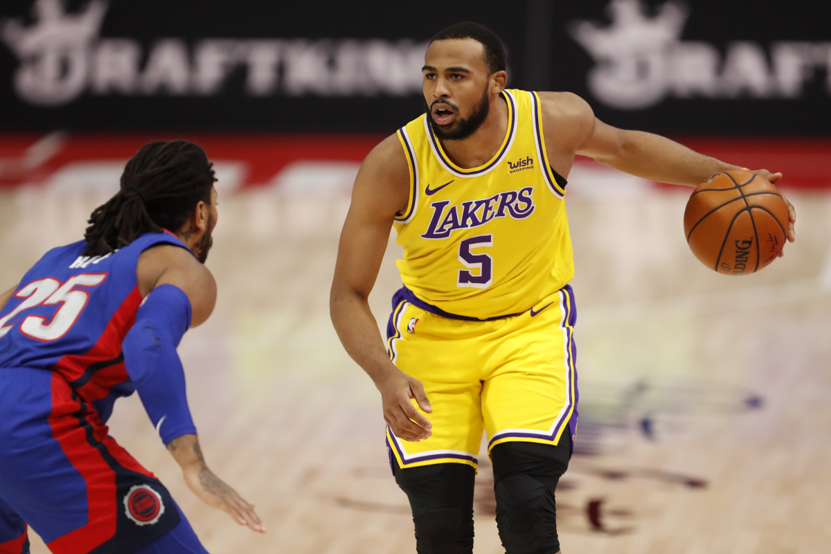 Lakers Talen Horton-Tucker guarded by Detroit's Derrick Rose/USA Today