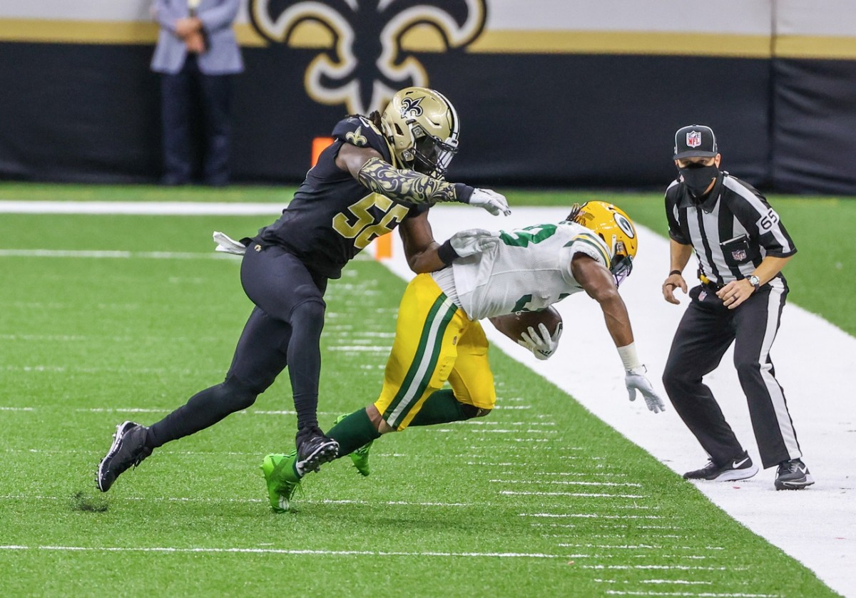 Sep 27, 2020; New Orleans, Louisiana, USA; Saints linebacker Demario Davis (56) tackles Packers running back Aaron Jones (33) during the second quarter at the Mercedes-Benz Superdome. Mandatory Credit: Derick E. Hingle-USA TODAY