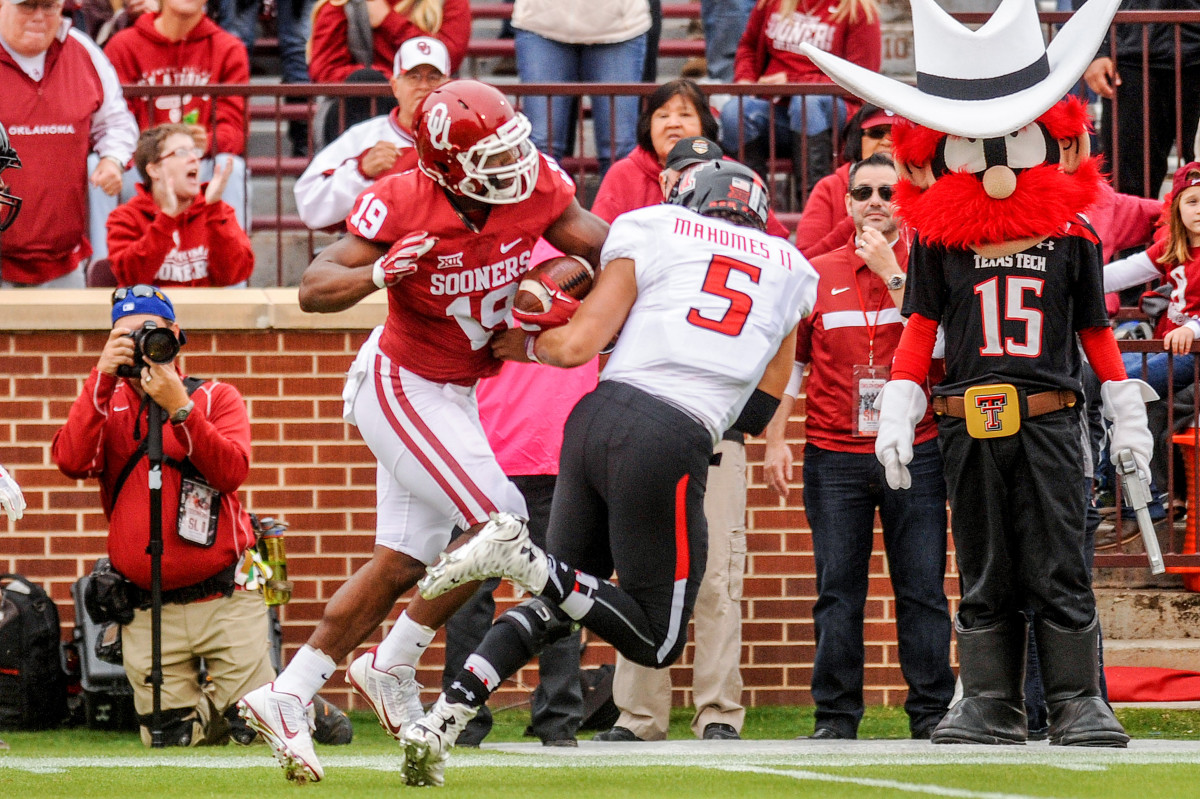 Mahomes ran into a brick wall in Norman, throwing four INTs as he tried to outshine Mayfield's Sooners on his own.