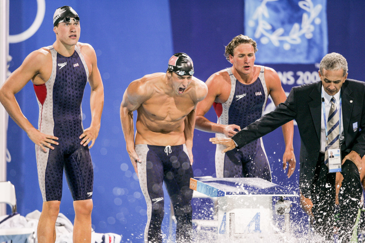 Phelps (center) cheered Keller to a 4x200 win over the Aussies in Athens.