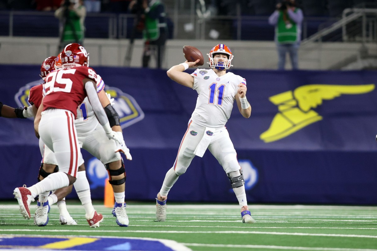 Dec 30, 2020; Arlington, TX, USA; Florida Gators quarterback Kyle Trask (11) throws a pass against the Oklahoma Sooners in the first quarter at ATT Stadium. Mandatory Credit: Tim Heitman-USA TODAY