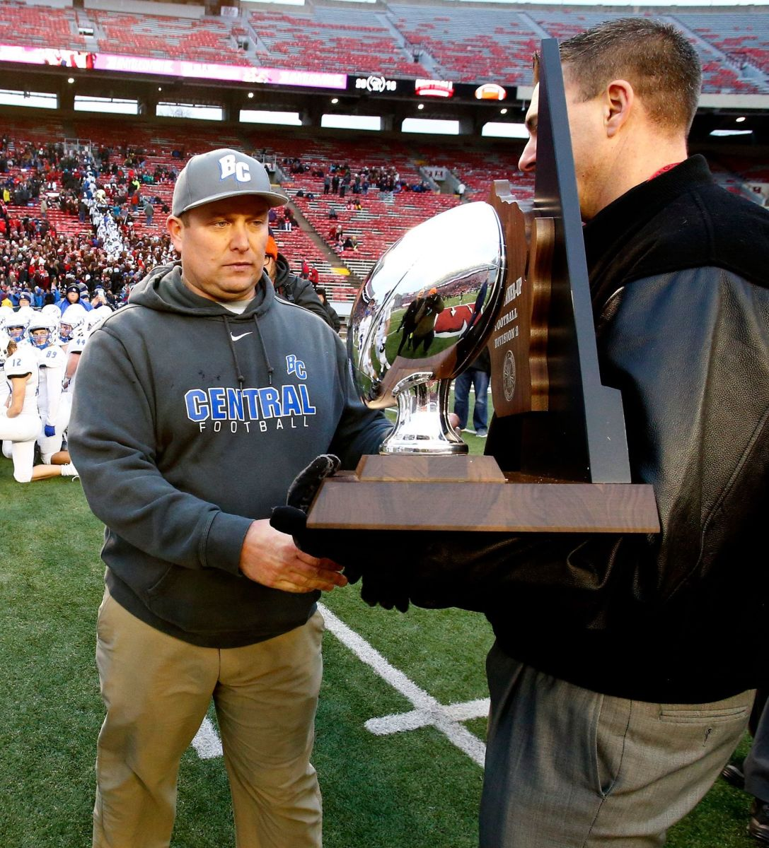 Brookfield (WIs.) Central High School football coach Jed Kennedy accepts the 2018 WIAA Division 2 runner-up trophy following the team's 51-14 loss to Homestead in Madison on Nov. 16.