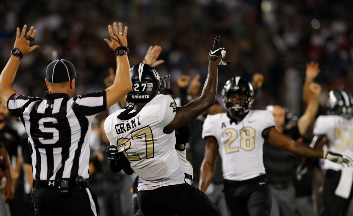 Grant (27) celebrates with teammates after intercepting a pass.Mandatory Credit: David Butler II-USA TODAY Sports