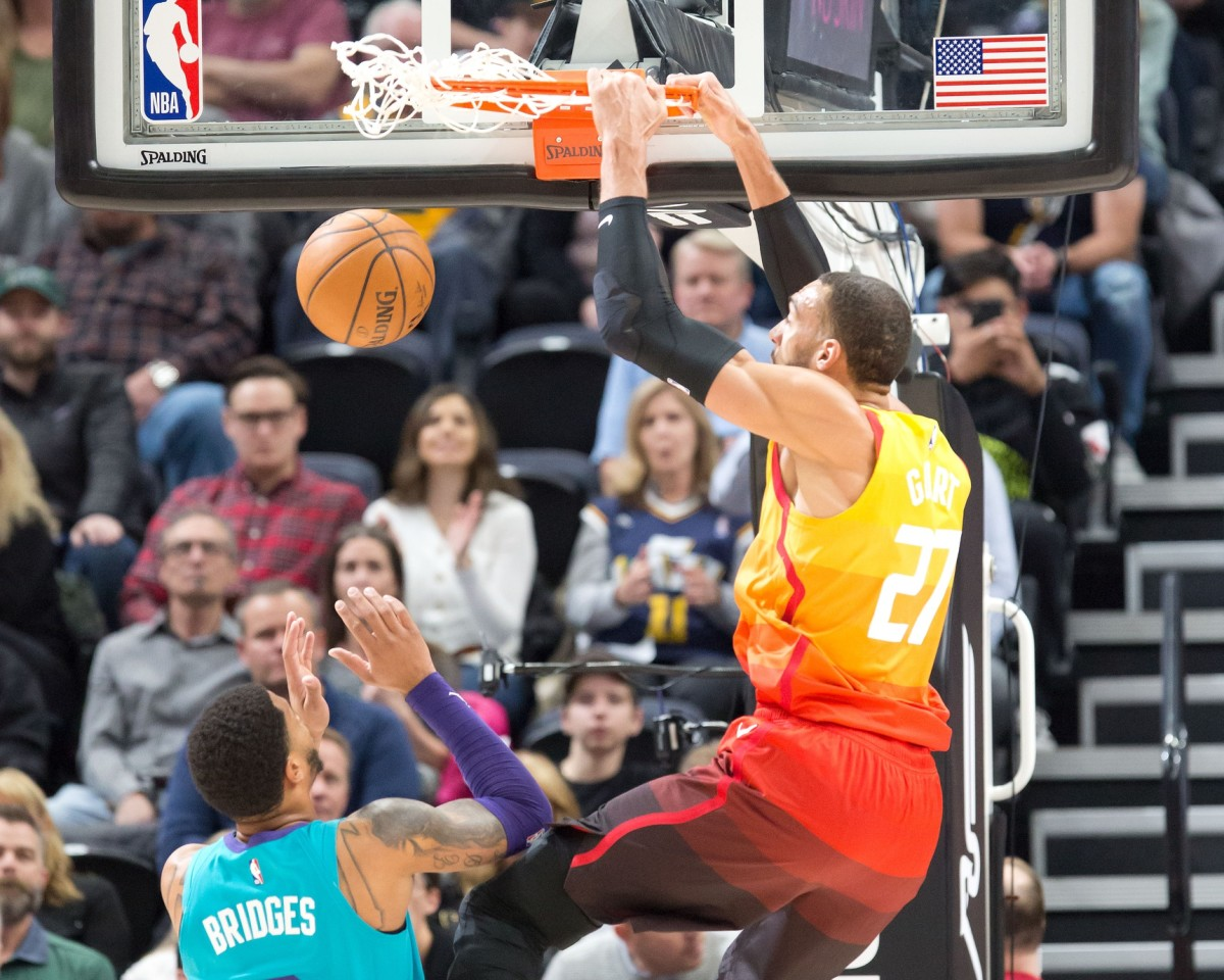 Rudy Gobert (27) dunks over Miles Bridges (0) in a game between the Utah Jazz and Charlotte Hornets