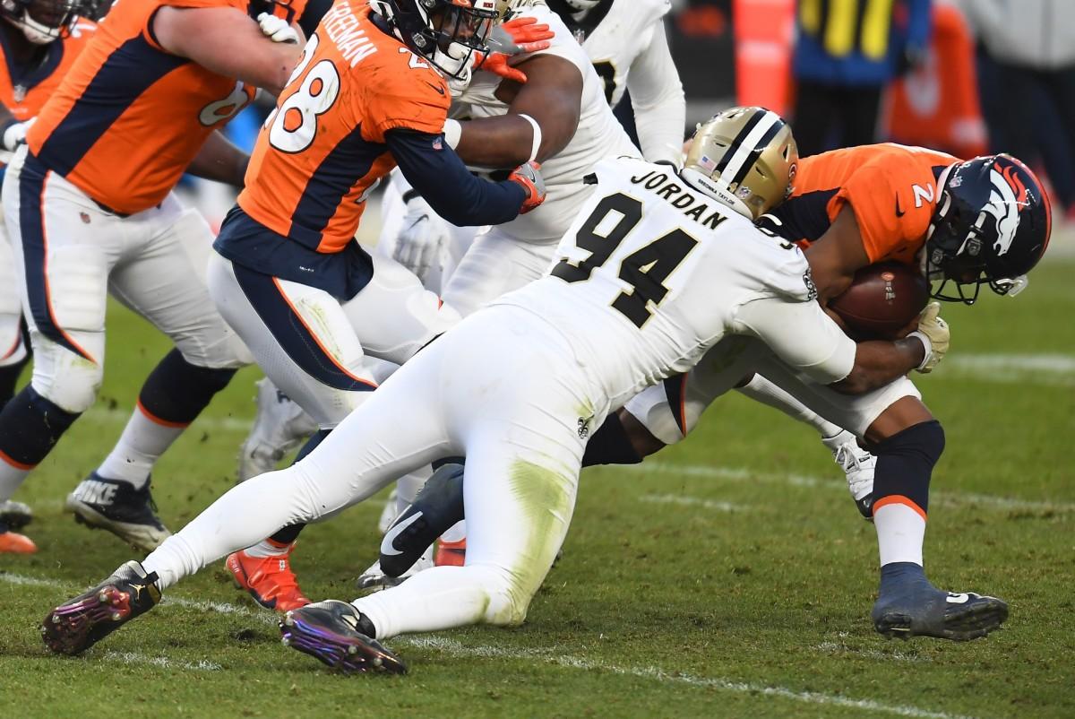 Nov 29, 2020; Denver, Colorado, USA; New Orleans defensive end Cameron Jordan (94) sacks Denver quarterback Kendall Hinton (2) at Empower Field at Mile High. Mandatory Credit: Ron Chenoy-USA TODAY