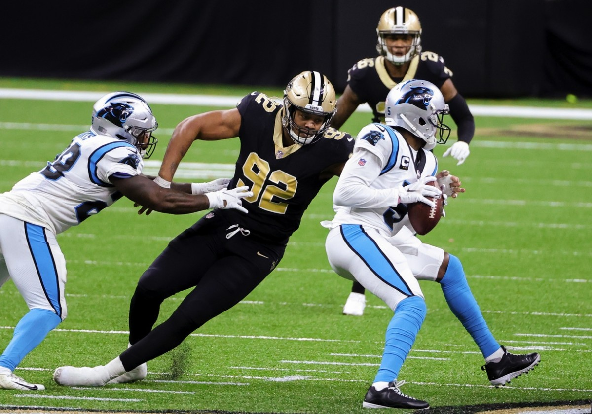 Oct 25, 2020; New Orleans, Louisiana, USA; Saints defensive end Marcus Davenport (92) sacks Carolina quarterback Teddy Bridgewater (5) at the Mercedes-Benz Superdome. Mandatory Credit: Derick E. Hingle-USA TODAY