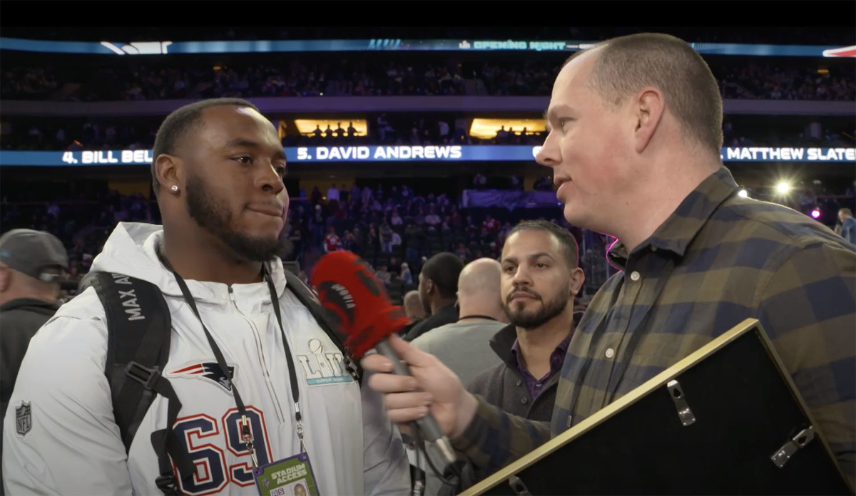 Danish journalist Tommy Kjærsgaard-Rasmussen interviews Patriots lineman Shaq Mason before Super Bowl LII