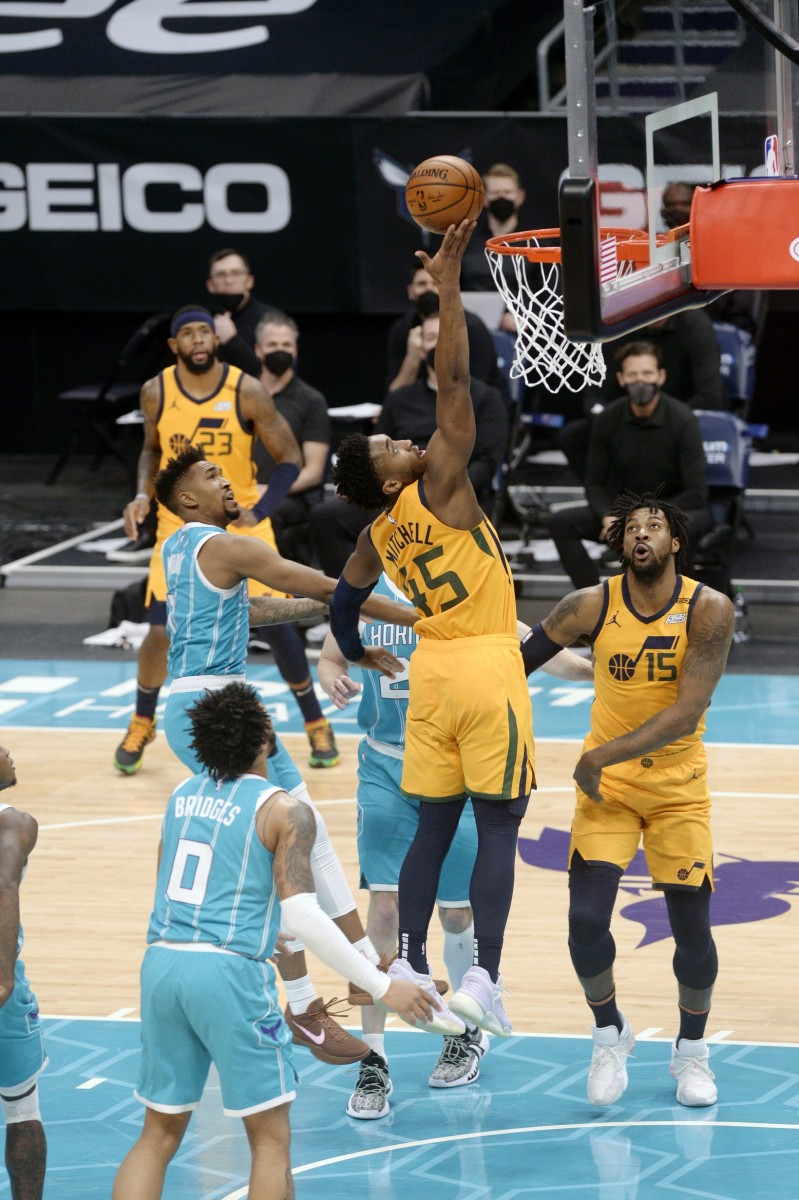 Donovan Mitchell (45) scores a layup against the Charlotte Hornets
