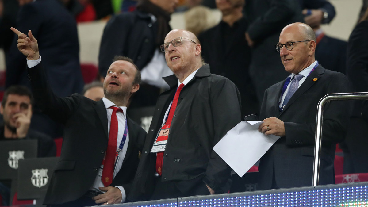 Ed Woodward with Manchester United owners Avram and Joel Glazer