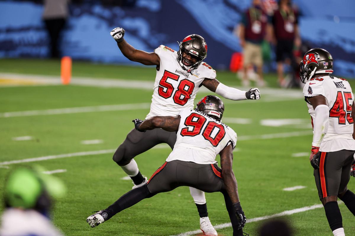 Bucs teammates Shaq Barrett and Jason Pierre-Paul celebrate a sack during Super Bowl LV