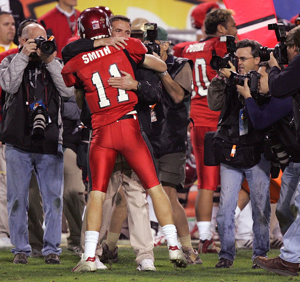 Alex Smith hugs his college Urban Meyer following a victory during the 2004 college football season