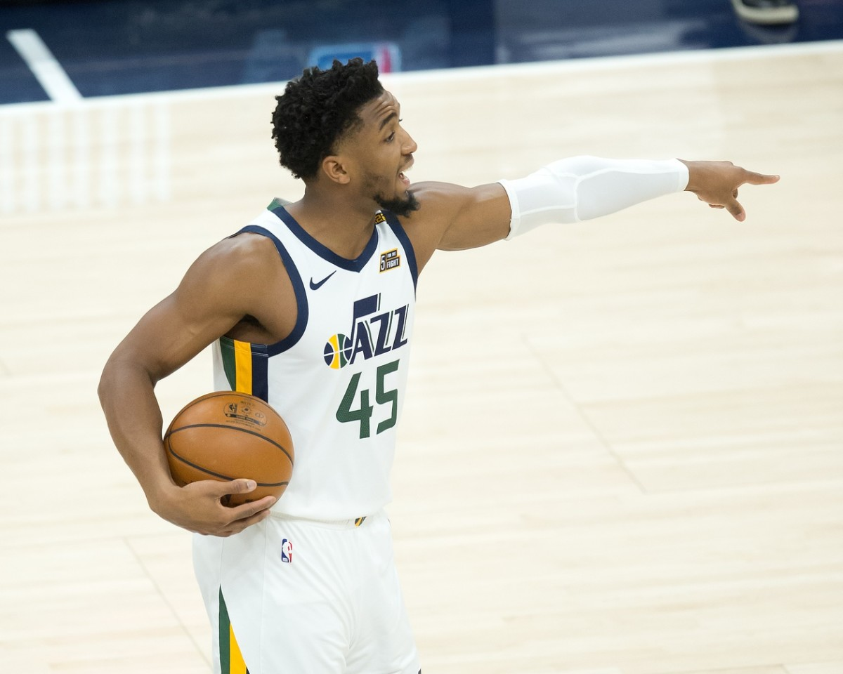 Donovan Mitchell (45) calls out a play in a game against the Boston Celtics