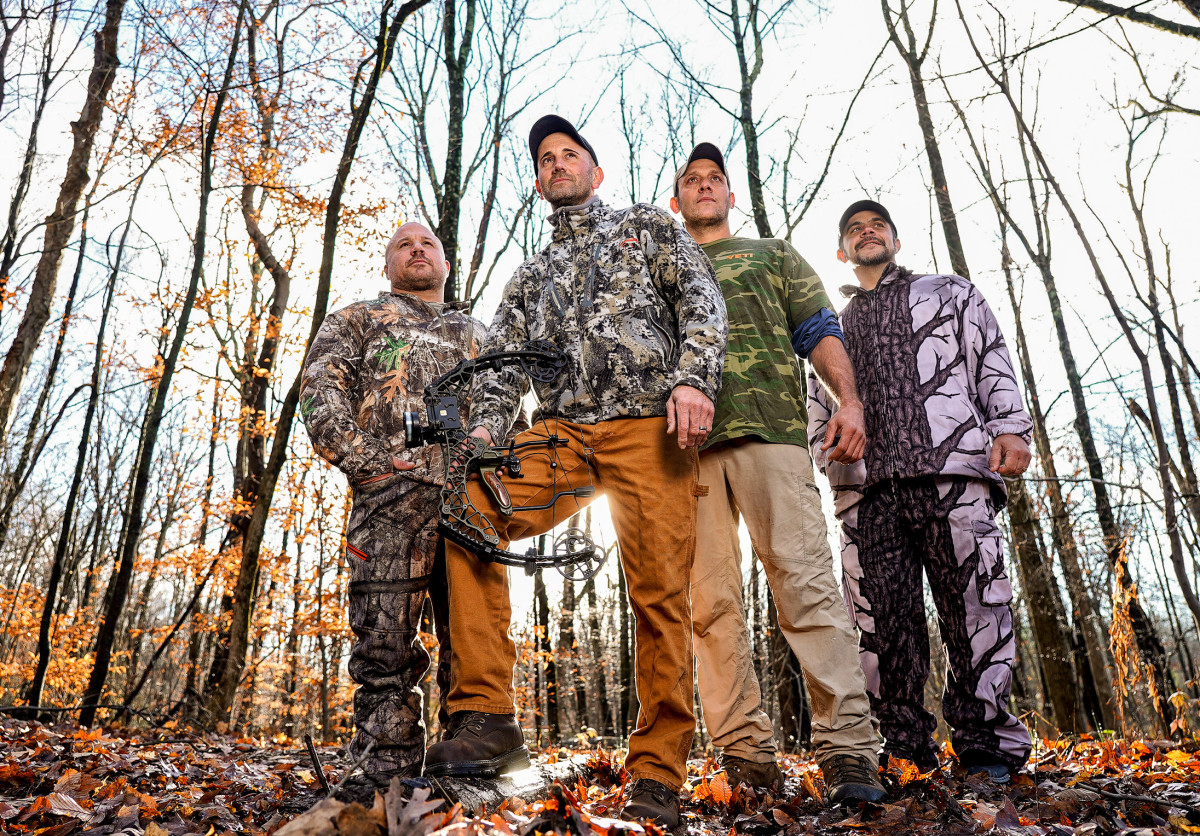 Melillo (holding bow) with Wayne Davis (second from right), who helped track the bear, and hunting buddies Marc Yodice and Jason Famularo.