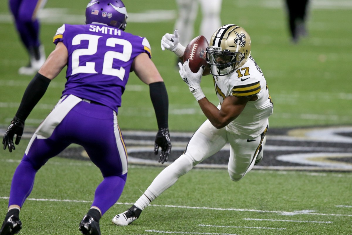 Dec 25, 2020; New Orleans, Louisiana, USA; New Orleans wide receiver Emmanuel Sanders (17) makes a catch in front of Minnesota safety Harrison Smith (22) in the second half at the Mercedes-Benz Superdome. Mandatory Credit: Chuck Cook-USA TODAY