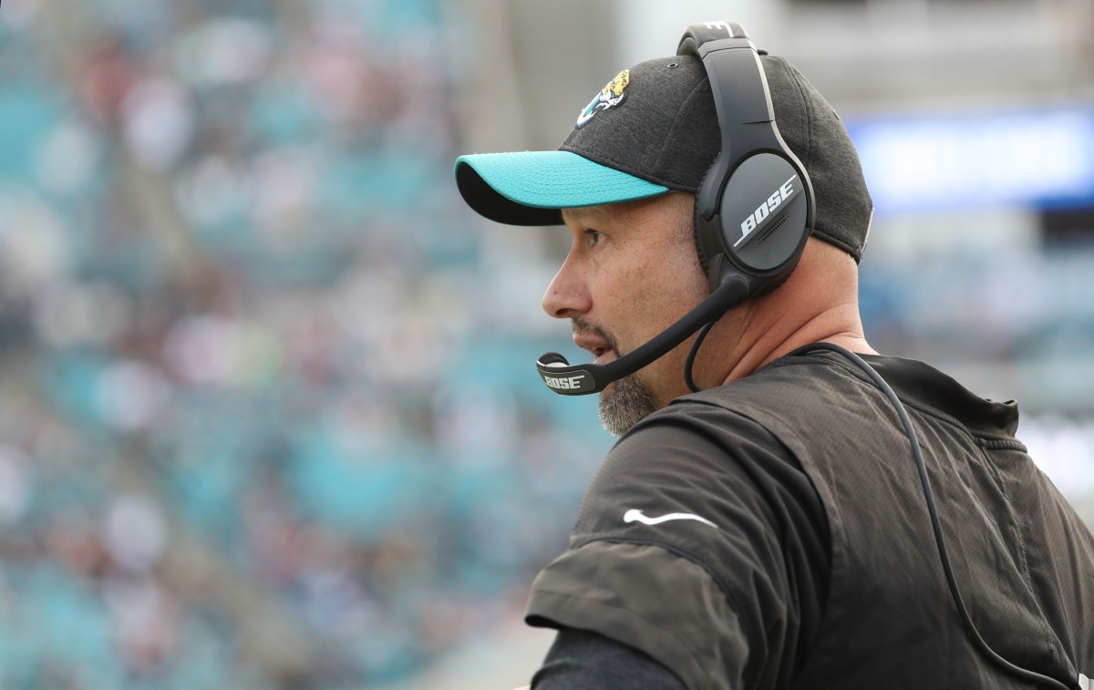 Scott Milanovich has been hired as Indianapolis Colts quarterbacks coach.