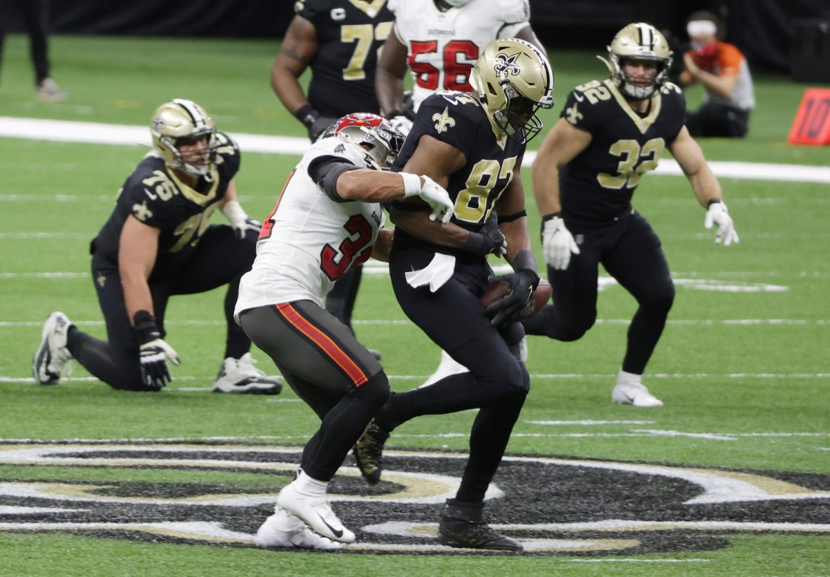 Jan 17, 2021; New Orleans, LA, USA; Tampa Bay safety Antoine Winfield Jr. (31) forces Saints tight end Jared Cook (87) to fumble during the third quarter in a NFC Divisional Round playoff game at Mercedes-Benz Superdome. Mandatory Credit: Derick E. Hingle-USA TODAY Sports