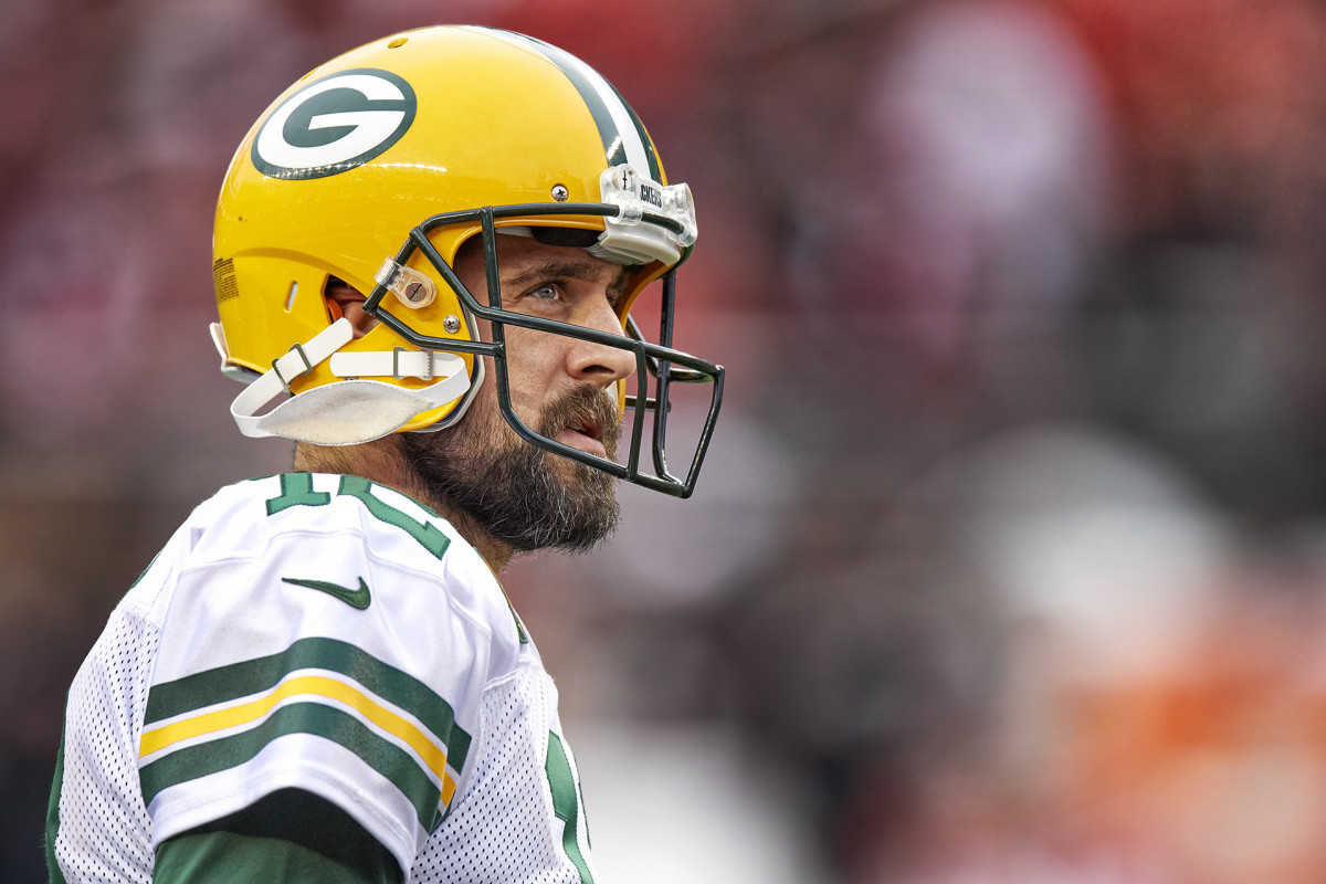 Aaron Rodgers looks to the stands during a break in the action of a Packers game