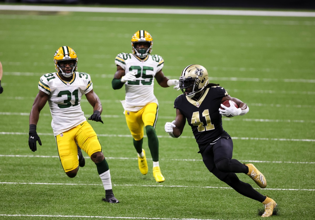 Sep 27, 2020; New Orleans, Louisiana, USA; Saints running back Alvin Kamara (41) breaks past Packers safety Adrian Amos (31) and cornerback Parry Nickerson (35) at the Mercedes-Benz Superdome. Mandatory Credit: Derick E. Hingle-USA TODAY