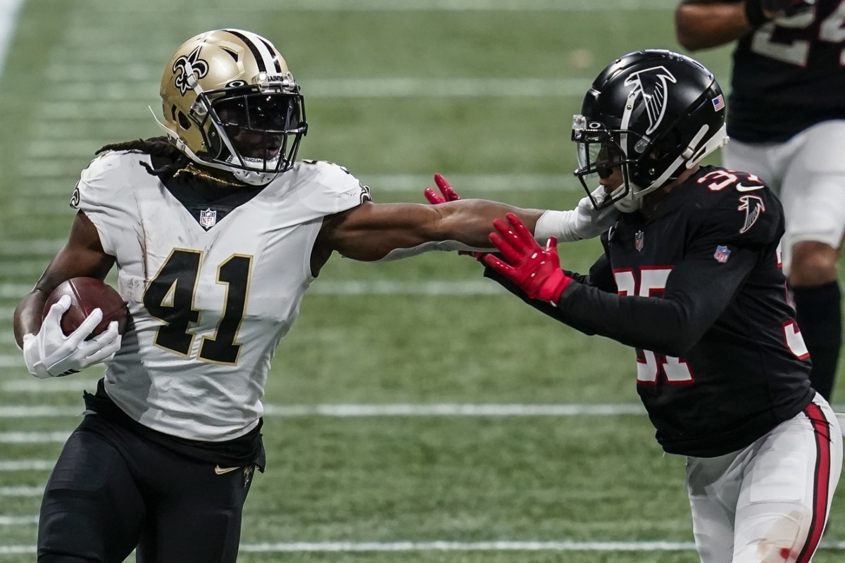 Dec 6, 2020; Atlanta, Georgia, USA; New Orleans running back Alvin Kamara (41) battles with Falcons safety Ricardo Allen (37) while running with the ball at Mercedes-Benz Stadium. Mandatory Credit: Dale Zanine-USA TODAY