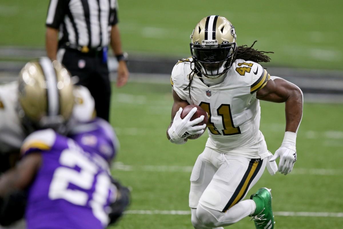 Dec 25, 2020; New Orleans, Louisiana, USA; Saints running back Alvin Kamara (41) runs against the Vikings at the Mercedes-Benz Superdome. Mandatory Credit: Chuck Cook-USA TODAY