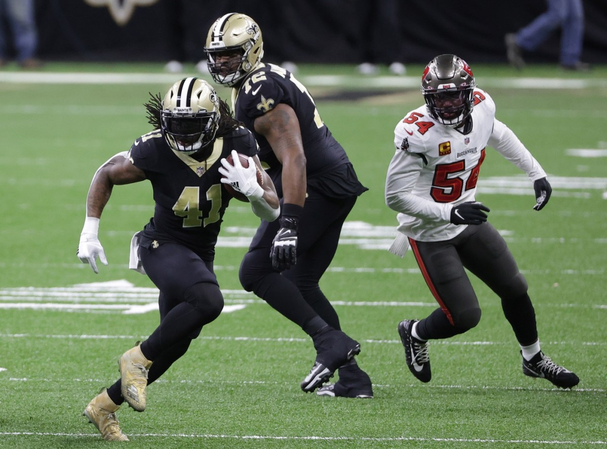Jan 17, 2021; New Orleans, LA, USA; Saints running back Alvin Kamara (41) runs the ball past Tampa Bay linebacker Lavonte David (54) in a NFC Divisional Round playoff game at Mercedes-Benz Superdome. Mandatory Credit: Derick E. Hingle-USA TODAY
