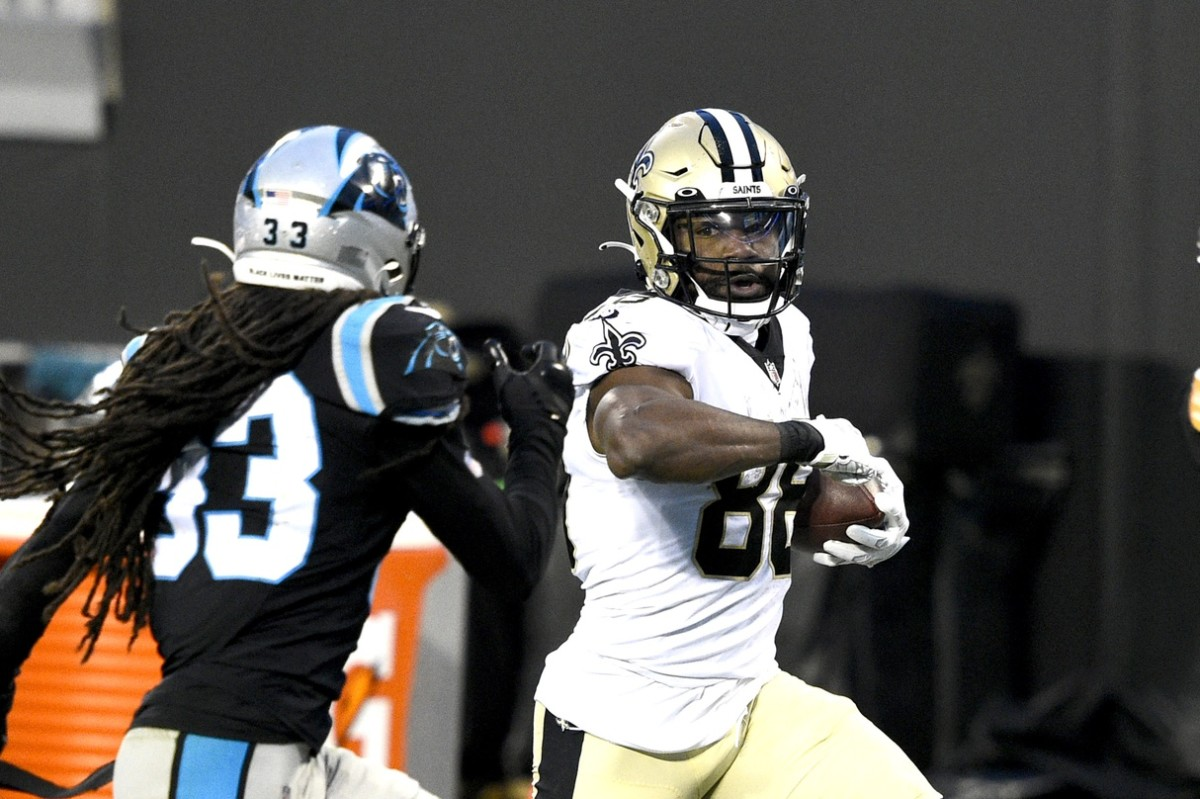 Jan 3, 2021; Charlotte, North Carolina, USA; New Orleans running back Ty Montgomery (88) with the ball as Panthers free safety Tre Boston (33) defends at Bank of America Stadium. Mandatory Credit: Bob Donnan-USA TODAY