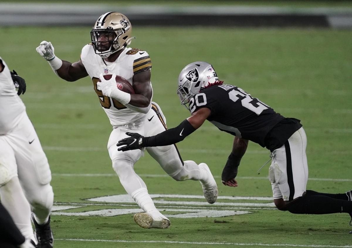 Sep 21, 2020; Paradise, Nevada, USA; Saints running back Ty Montgomery (88) runs the ball against Raiders cornerback Damon Arnette (20) at Allegiant Stadium. Mandatory Credit: Kirby Lee-USA TODAY