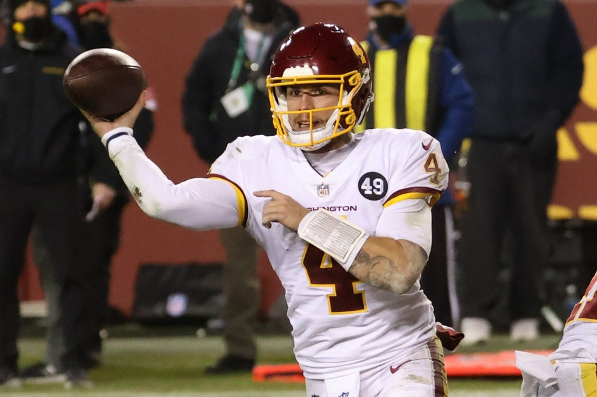 Jan 9, 2021; Landover, Maryland, USA; Washington Football Team quarterback Taylor Heinicke (4) passes the ball against the Tampa Bay Buccaneers at FedExField.