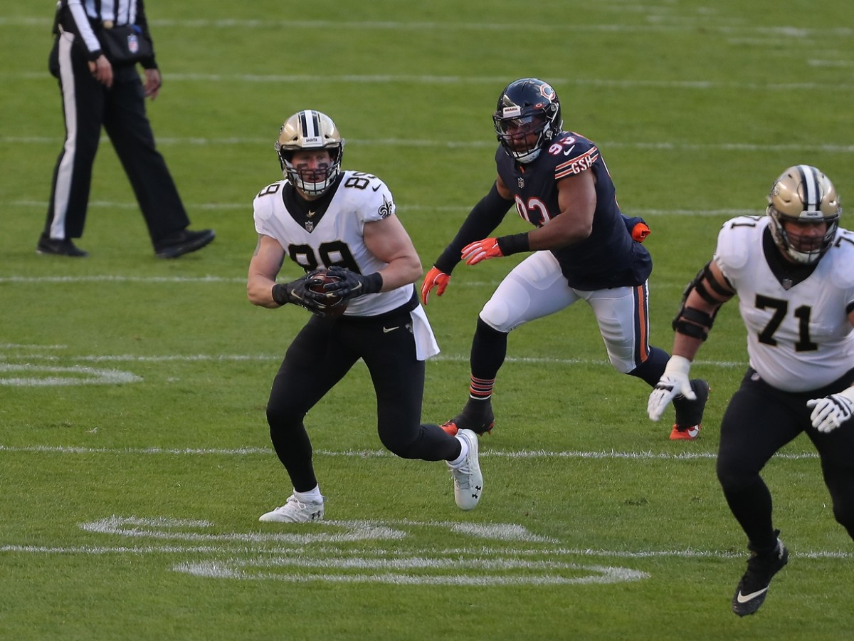 Nov 1, 2020; Chicago, Illinois, USA; Saints tight end Josh Hill (89) runs with the ball with Bears linebacker James Vaughters (93) in pursuit at Soldier Field. Mandatory Credit: Dennis Wierzbicki-USA TODAY