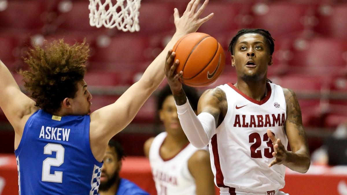 Alabama's John Petty Jr. drives to the basket against Kentucky.