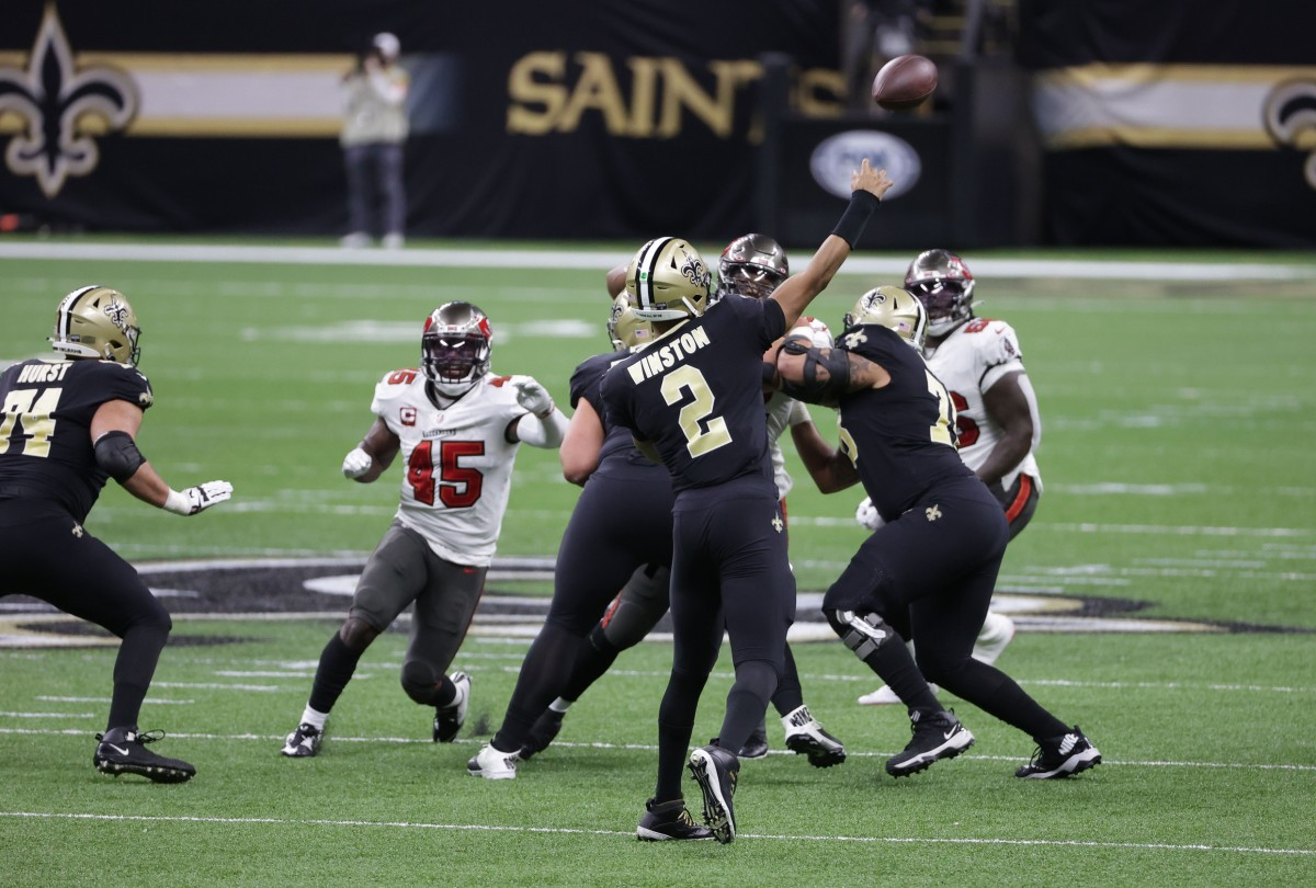 Jan 17, 2021; New Orleans, LA, USA; Saints quarterback Jameis Winston (2) throws a touchdown pass to wide receiver Tre'Quan Smith (not pictured) against the Buccaneers in a NFC Divisional Round playoff game at Mercedes-Benz Superdome. Mandatory Credit: Derick E. Hingle-USA TODAY